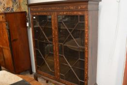 An early 19th century Continental marquetry-inlaid cabinet on stand, with hinged top inside a