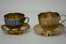 Two Chinese Export silver teacups and saucers, one with panelled body and engraved with Chinese