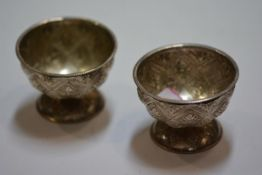 A pair of Continental white metal large salts, of bowl form, each chased with a trellis pattern of