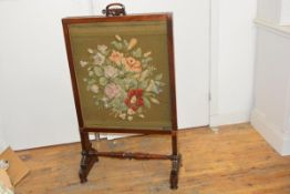 A William IV mahogany fire screen, the sliding panel with scroll carved panel over a silk