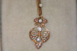 A diamond and seed pearl set 14ct gold pendant in the Edwardian taste, of shaped leaf design,