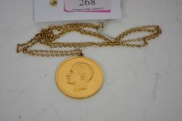 Pahlavi Dynasty, a gold medal, with a bust of the Shah obverse, an Islamic inscription within a