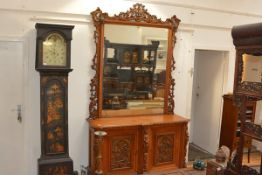 An imposing late Victorian carved oak mirror-backed hall cabinet, the rectangular mirror plate