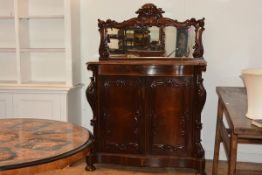 A good mid-Victorian rosewood chiffonier, the mirror back with a boldly scroll-carved frame above