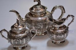 A Chinese three piece white metal tea service, c. 1900, each piece of globular form, with bamboo-