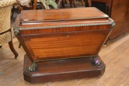 A handsome Regency brass-inlaid and mounted rosewood crossbanded mahogany cellarette, of sarcophagus