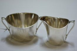 A Hans Hansen silver cream jug and sugar bowl, of simple ovoid form, each with import marks for