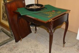 An Edwardian mahogany roulette and games table, the rectangular top with serpentine moulded edge