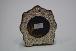A silver-mounted photograph frame in the Victorian taste, London 1982, the circular aperture (