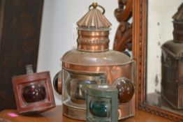 A copper ship's lantern, of semi-circular form, with red and green glass indicators, with maker's