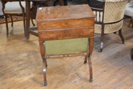 An early 19th century burr walnut work table, the hinged top with moulded edge opening to a fitted