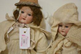 Two German bisque head dolls, c. 1900, one Heubach Koppelsdorf pattern no. 275.8/0, with blue
