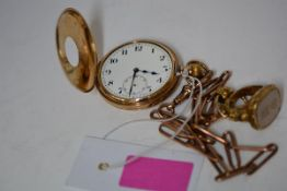 A 9ct gold half hunter pocket watch, the case with enamelled Roman numeral chapter ring, enclosing a