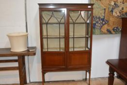 An Edwardian mahogany vitrine cabinet, with moulded cornice above a pair of astragal glazed doors,