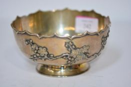 A Chinese silver bowl, c. 1900, Kwan Wo, Canton or Hong Kong, with petal lobed rim, the body applied