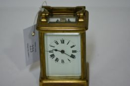 """A French brass-cased carriage clock, early 20th century, stamped to the reverse """"Made in France"""","""