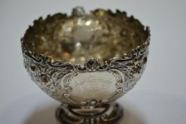 A late Victorian silver footed bowl, Walker & Hall, Sheffield 1900, chased with flowers, leaves
