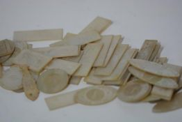 A collection of approximately fifty-five Chinese Export mother of pearl gaming tokens, primarily