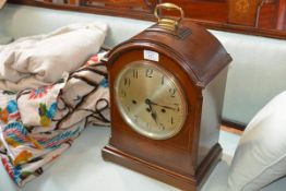 An early 20th century German bracket clock, the silver dial with Arabic numerals within an arched