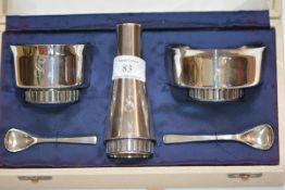 A vintage silver three piece condiment set, Christopher Nigel Lawrence, London 1968, the salt,