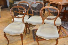 A set of five Victorian balloon back drawing room chairs, each with shell carved seat rail,