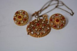 A suite of Indian coral and pearl mounted gold jewellery, a pendant and earrings en suite, each of
