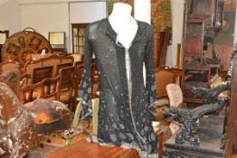 A vintage heavily beaded lady's evening jacket, decorated with clear and black bugle beads in
