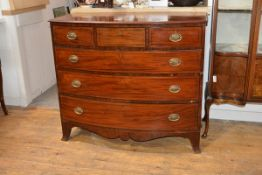 A George III bowfronted mahogany chest of drawers, with three frieze drawers over three long