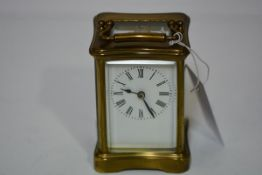 A French brass-cased carriage clock, early 20th century, of characteristic form, the white enamel