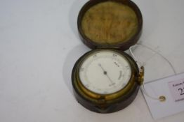 A 19th century pocket barometer, mounted in gilt metal, the dial unsigned, in its original fitted