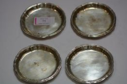 A set of four Continental silver small coasters or dishes, 800 standard, each with scalloped rim,