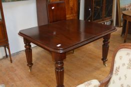 An early Victorian mahogany wind-out dining table, with two leaves, the moulded top with rounded
