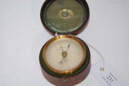 A 19th century Negretti & Zambra cased pocket barometer, in gilt-brass, with original leather velvet