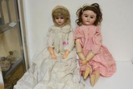 Two large German bisque head dolls, c. 1900, one Max Handwerck no. 283/31s, each with sleeping