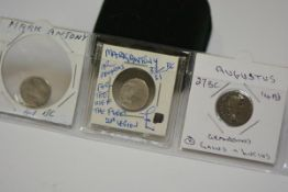 Two Roman coins, Mark Anthony denarii (fleet type), one Augustus denarius Lugdunum type and Quadrans