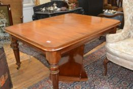 An early Victorian mahogany extending dining table, the rectangular top with rounded corners and