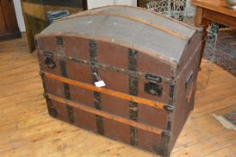 A large 19th century dome top travelling trunk, with studded wooden bands, the interior fitted
