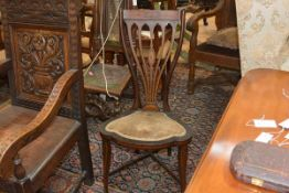 An Edwardian inlaid mahogany drawing room chair, the tablet crest rail decorated with an oval patera