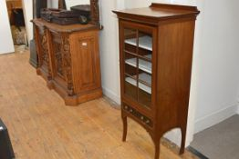 An Edwardian mahogany music cabinet, the rectangular crossbanded top above a glazed door enclosing