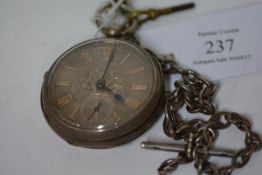 A late Victorian silver open face pocket watch, the case marked for Chester 1889, the silvered
