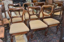 A matched set of six Victorian balloon back chairs comprising: four walnut chairs, each with