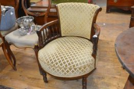 An early Victorian rosewood open armchair, the scroll back above a shaped circular stuffed over