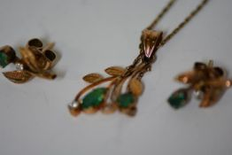 A suite of emerald and diamond set jewellery comprising a pendant and pair of earrings en suite