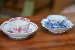 Two Meissen cabinet cups and saucers, one in the Blue Onion pattern, of quatrefoil shape, underglaze