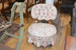 A small Victorian walnut-framed nursing chair, the buttoned back raised on scroll-carved supports