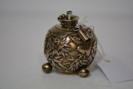 A Chinese silver table lighter, last quarter 19th century, of spherical form, chased with birds