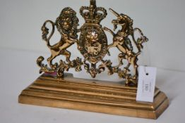 A 19th century brass door stop, cast as the Royal Coat of Arms. 23cm by 31cm