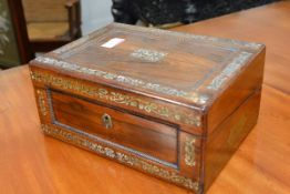 A 19th century mother of pearl inlaid rosewood writing slope, of characteristic form, decorated with