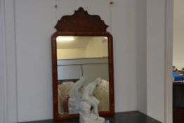 A George II style red lacquer mirror, the arched rectangular plate within a conforming frame beneath