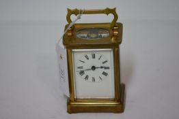 A French brass-cased carriage clock, Richard & Co,. Paris, the white enamel dial with Roman